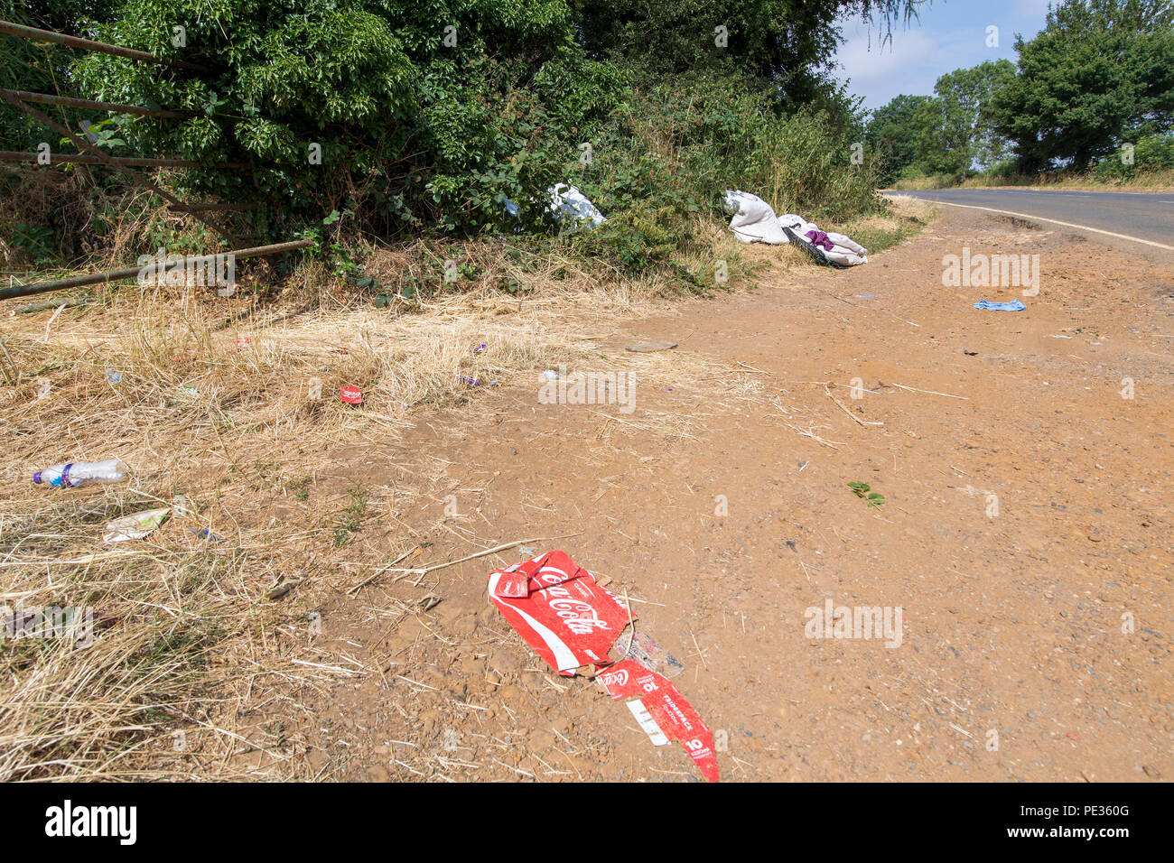 Rubbish in a layby next to a busy main road. Cotswolds, UK. - Stock Image