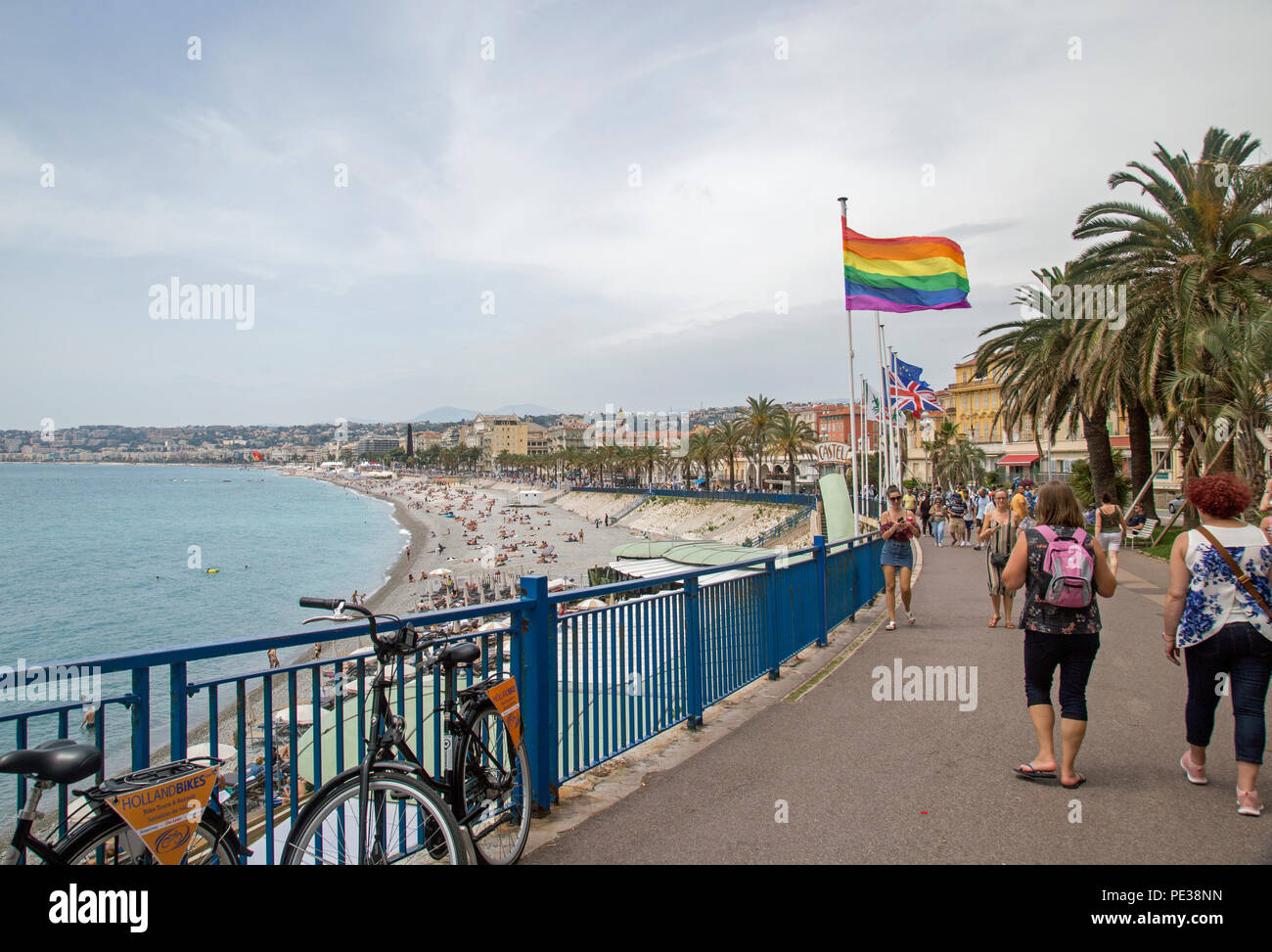 June 2018, Nice, France, A freedom flag flies on the promenade indicating gay friendly credentials. - Stock Image