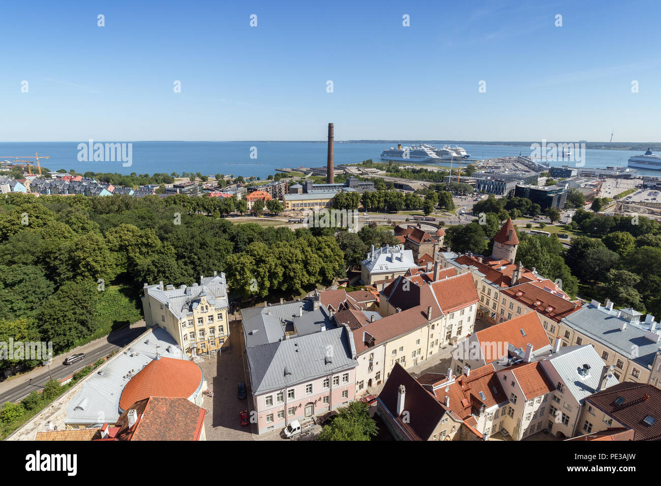 Old buildings at the Old Town, harbor and downtown in Tallinn, Estonia, viewed from above on a sunny day in the summer. - Stock Image