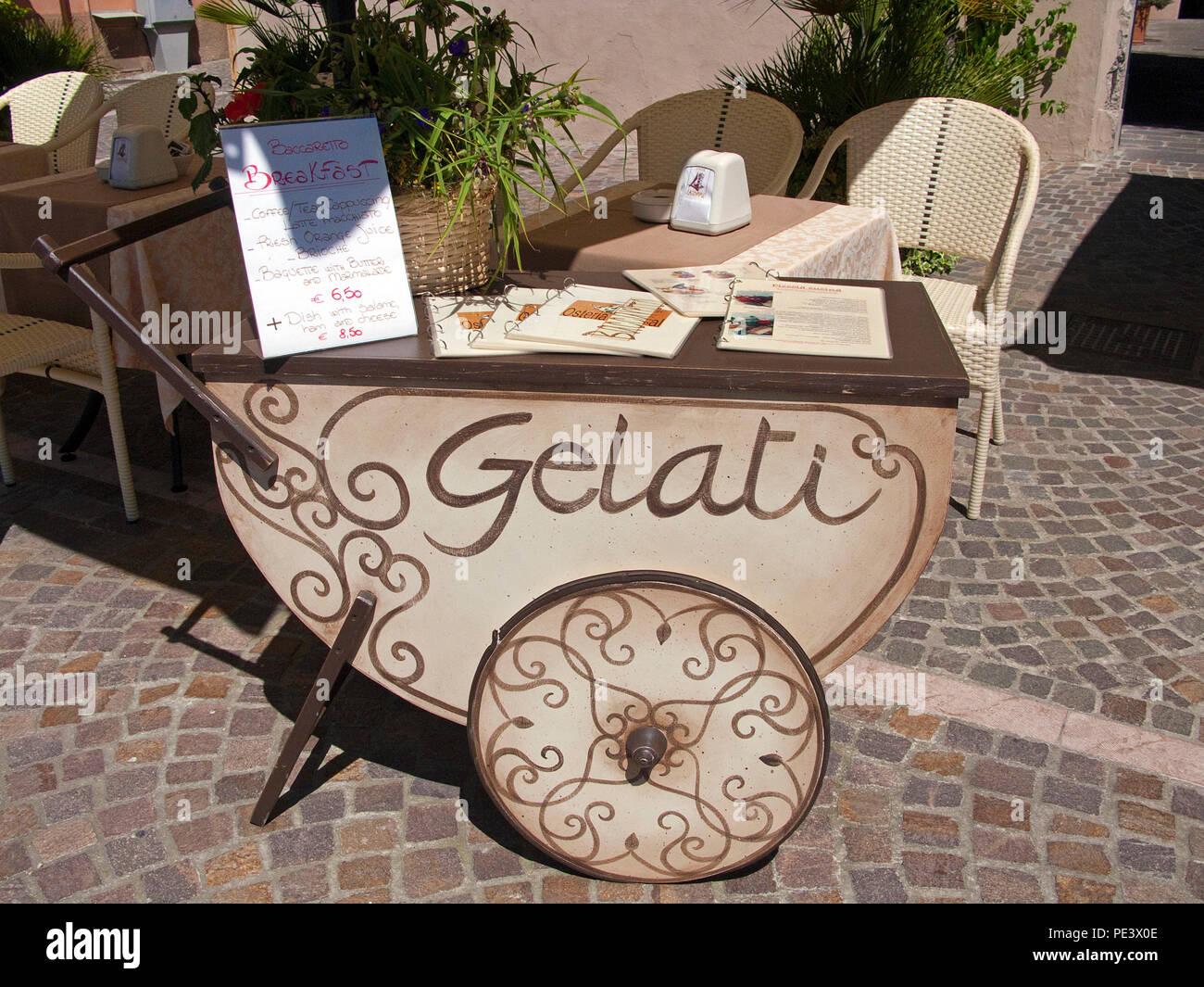 Retro ice cream cart at a Osteria, Gargnano, province Brescia, Garda lake, Lombardy, Italy Stock Photo