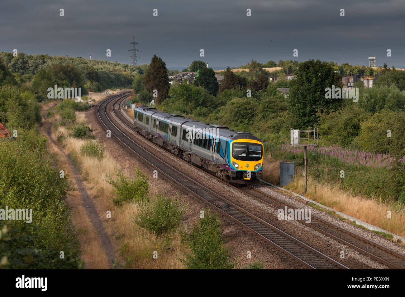 A First Transpennine express class 185 disel train passing Kilnhurst (south of Swinton, Yorkshire) with a  Manchester Airport to Cleethorpes service - Stock Image