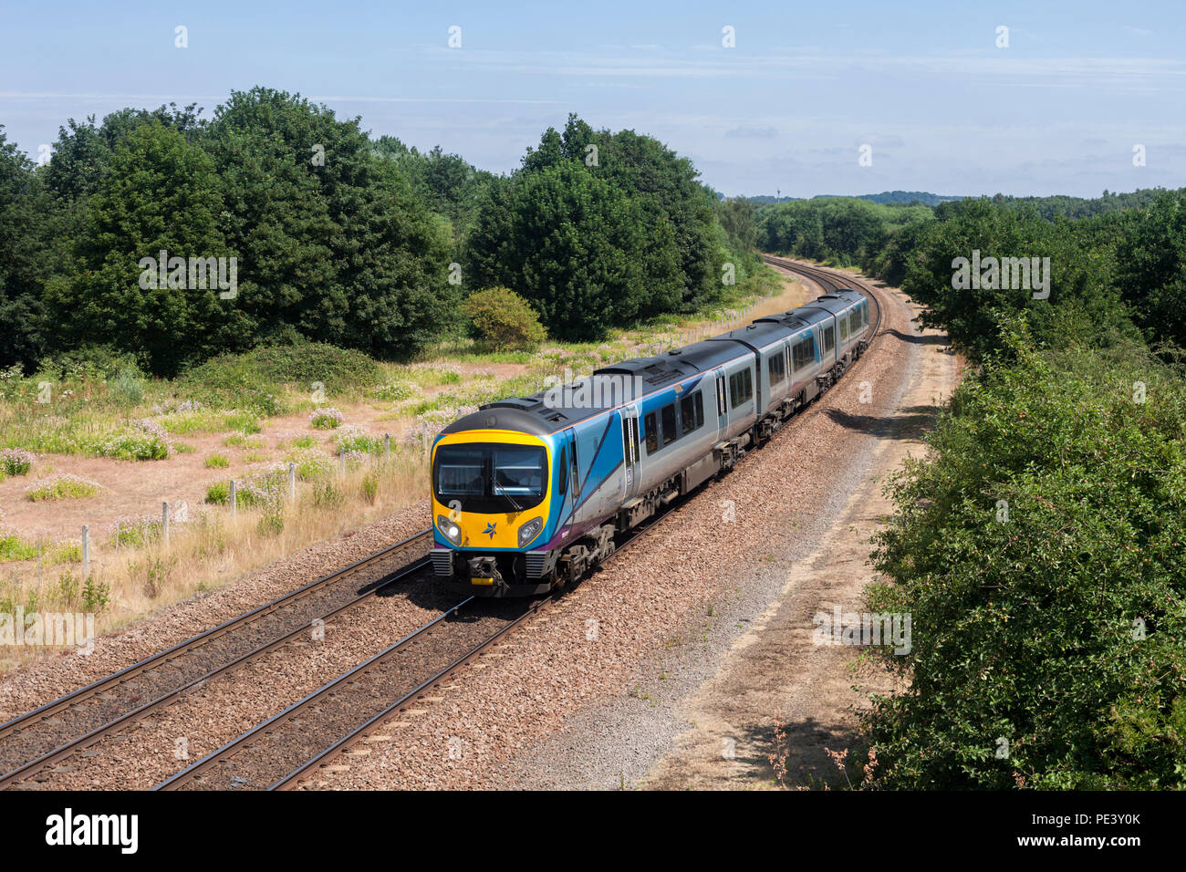 A Transpennine Express class 185 diesel train passing Old Denaby (east of Mexborough, South Yorkshire) with a Cleethorpes to  Manchester Airport train - Stock Image