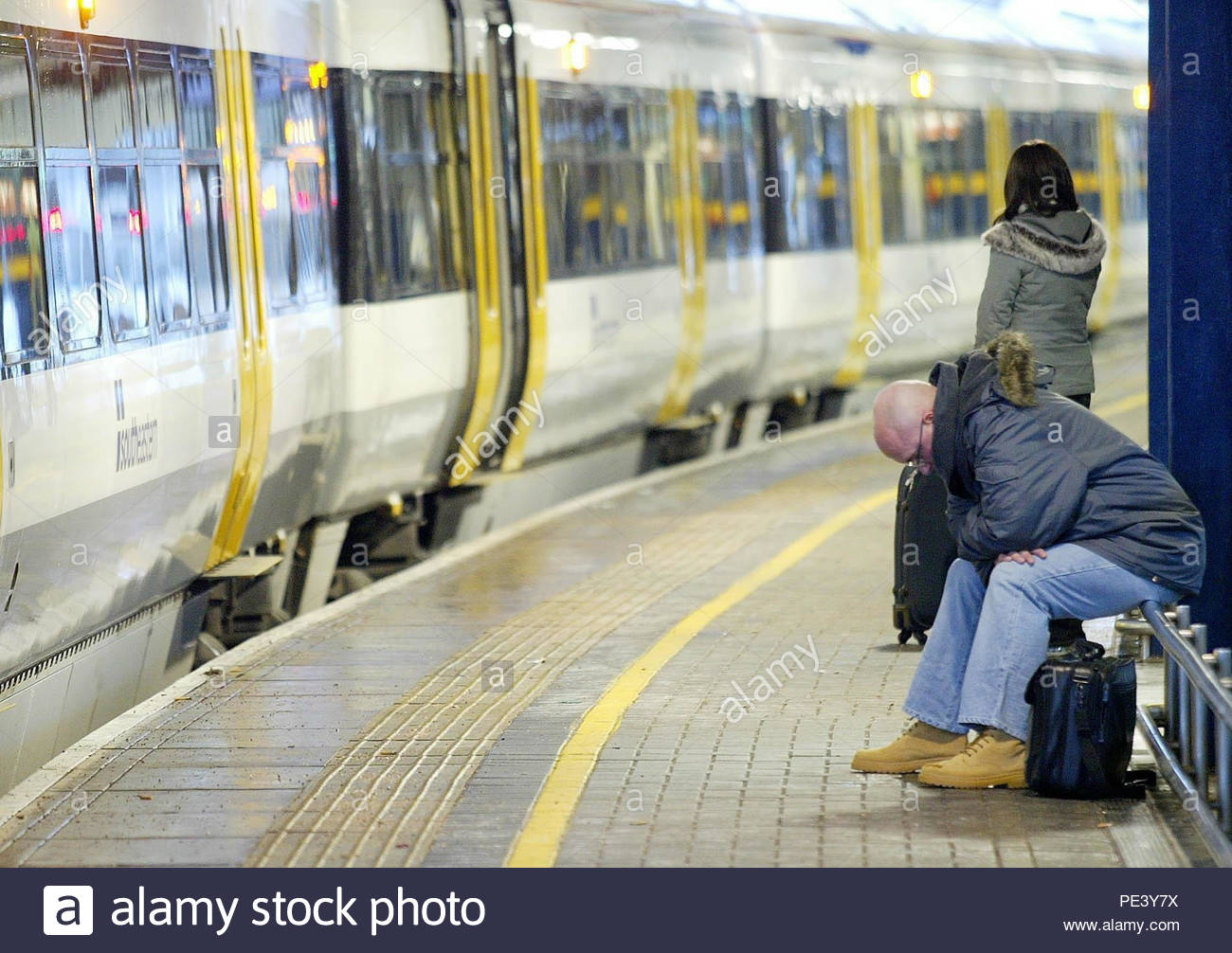 Embargoed to 0001 Monday August 13 File photo dated 29/12/05 of commuters waiting for trains during the rush hour. Passenger satisfaction with rail punctuality and reliability has fallen over the past decade, figures show. - Stock Image