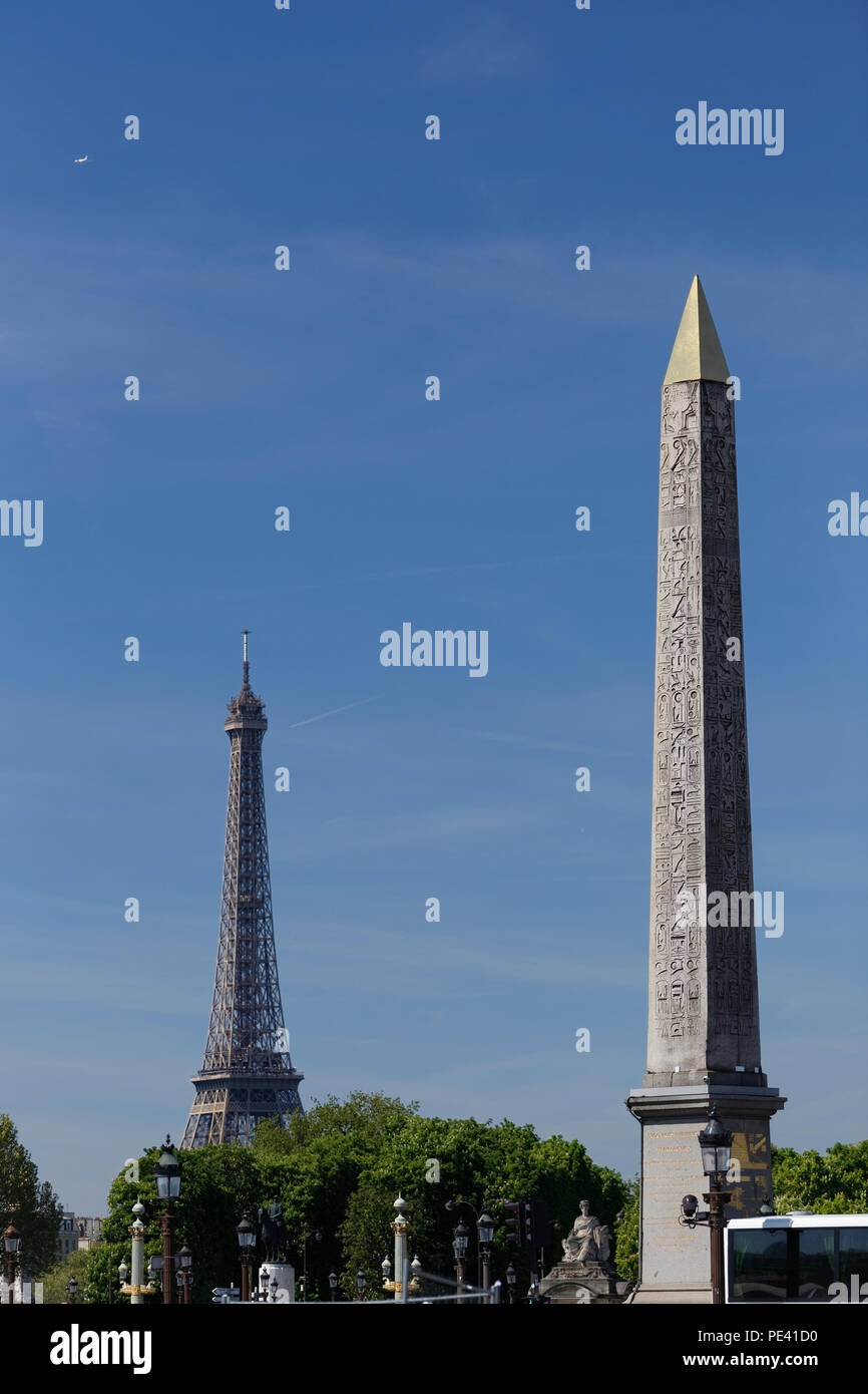 Place de la Concorde in historical part of Paris city. Obelisk of Luxor  with a view of Eiffel tower in background. - Stock Image