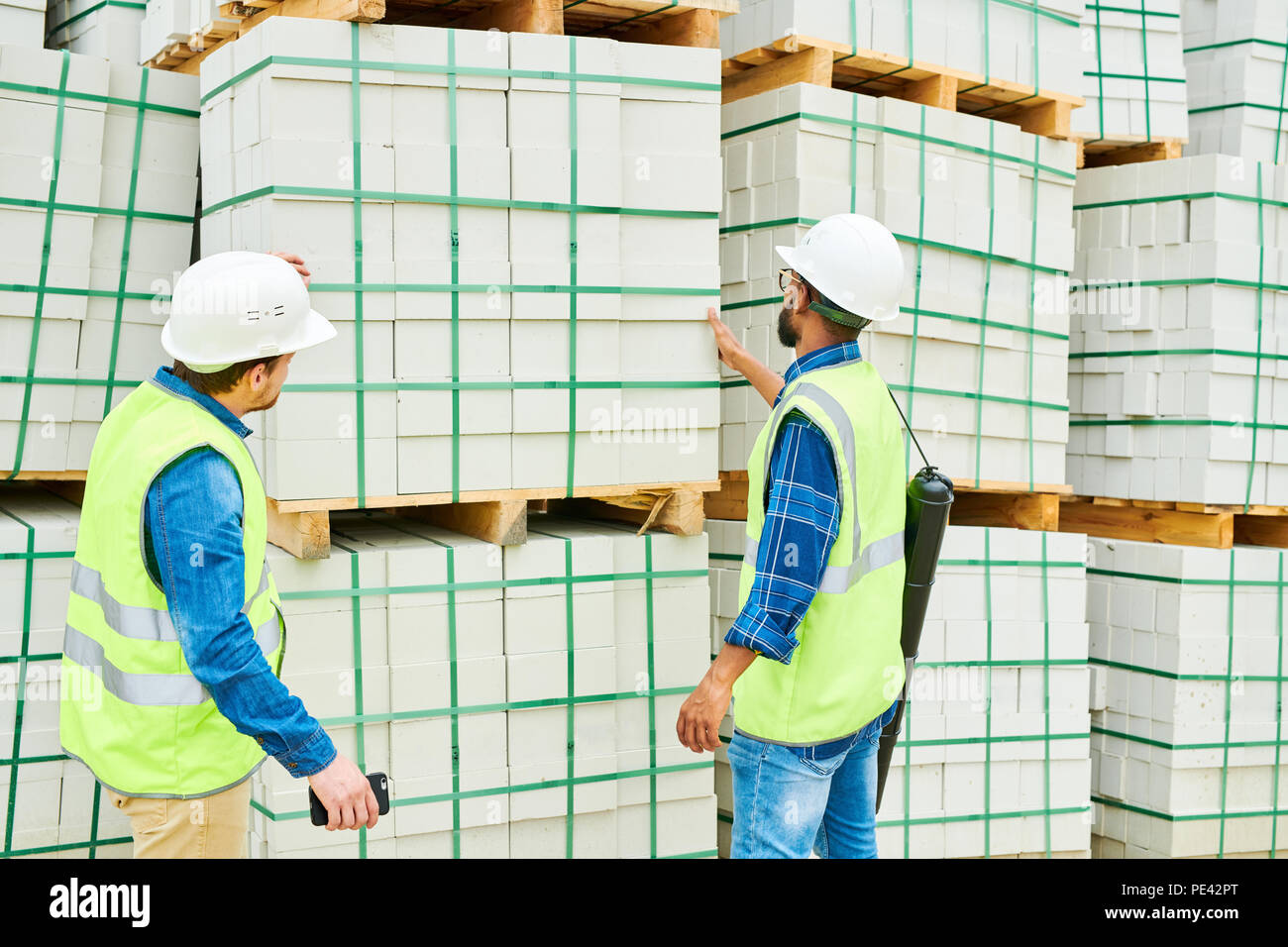 Anonymous building inspectors looking at materials - Stock Image