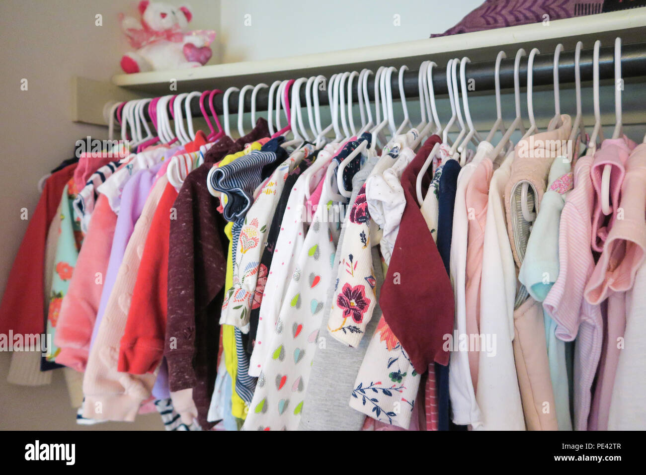 Closet in Baby Girl's Room, USA - Stock Image