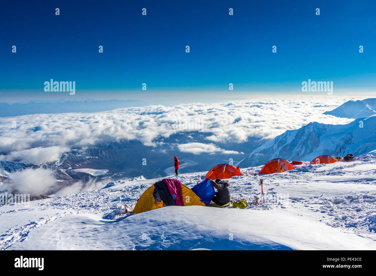 A Campsite Above The Clouds On Pik Lenin In Kyrgyzstan At 6100m