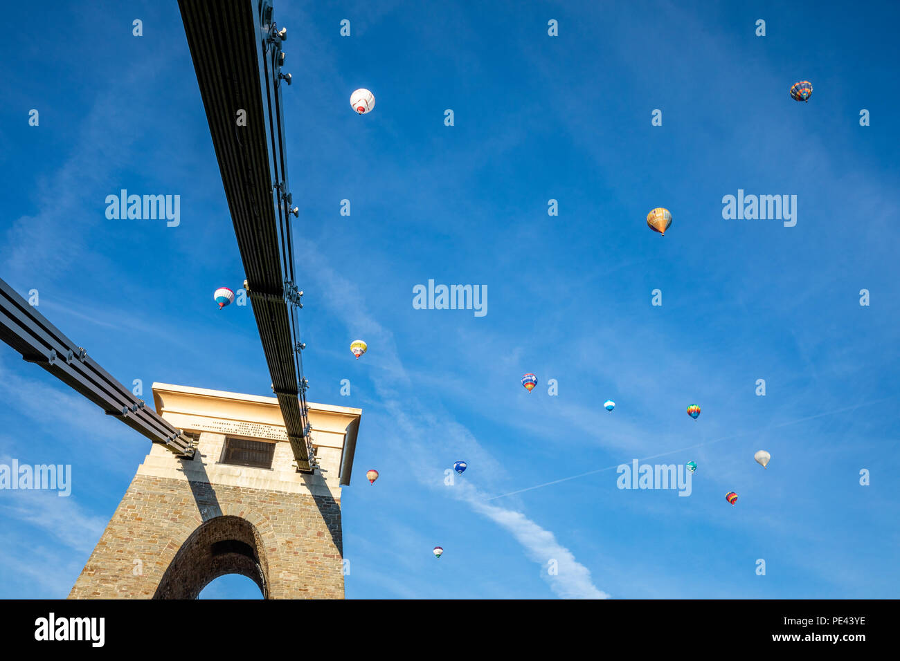 Hot air balloons in flight above the Clifton suspension bridge during the mass ascent of the Bristol Balloon Fiesta - Stock Image