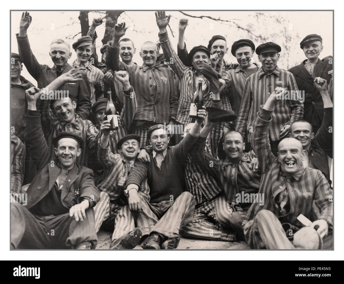 DACHAU LIBERATION Polish prisoners in Dachau concentration camp celebrating their liberation when Allied soldiers liberated the camp April 29, 1945, Dachau was surrendered to Brig. Gen. Henning Linden of the 42nd Infantry Division of the U.S. Army by Untersturmführer Wicker. during World War II Gen. of the Army Dwight D. Eisenhower issued a communiqué regarding the capture of Dachau concentration camp: 'Our forces liberated and mopped up the infamous concentration camp at Dachau. Approximately 32,000 prisoners were liberated; 300 SS camp guards were quickly neutralized. - Stock Image