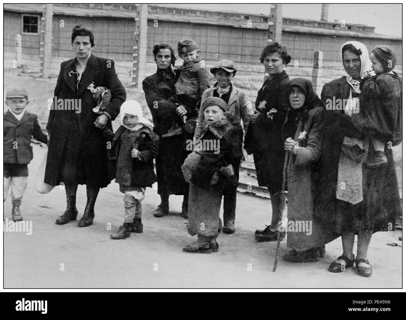 "Jewish children with their mothers and grandmothers arrive in Auschwitz-Birkenau. A WW2 German Nazi Concentration & Extermination camp. Jewish children made up the largest group of those deported to the camp. They were usually sent there along with adults, beginning in early 1942, as part of the ""final solution of the Jewish question""—the total destruction of the Jewish population of Europe...Auschwitz concentration camp was a network of German Nazi concentration camps and extermination camps built and operated by the Third Reich in Polish areas annexed by Nazi Germany during World War II. - Stock Image"
