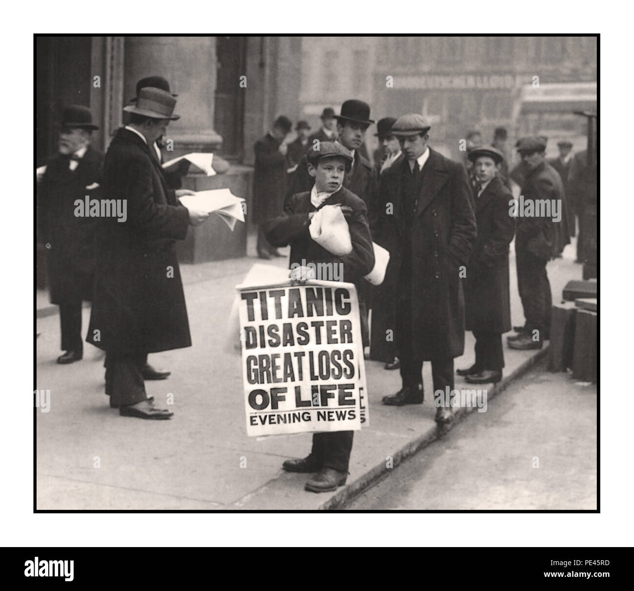 RMS Titanic disaster headline news, newspaper newsboy seller with banner declaring 'TITANIC DISASTER GREAT LOSS OF LIFE' Evening News White Star Line Cockspur Street  London UK - Stock Image