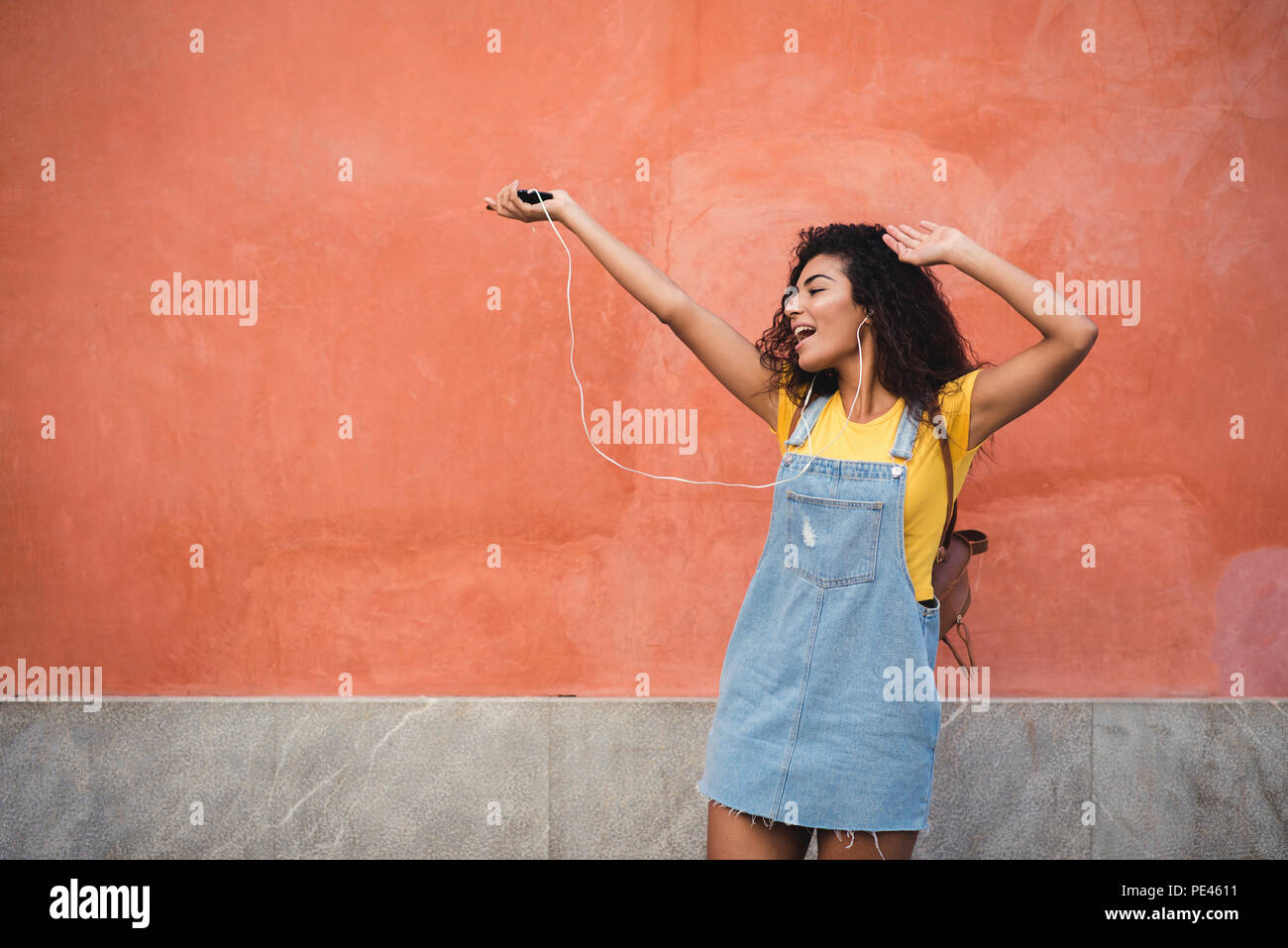 Young Black Woman With Curly Hair Having Fun In The Urban
