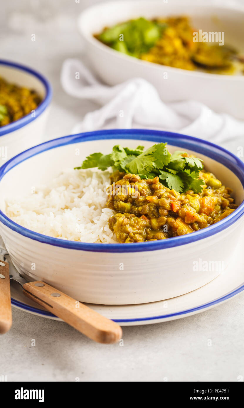 Lentil curry with rice, Indian cuisine, tarka dal, white background. Vegan food. Clean eating concept. Stock Photo