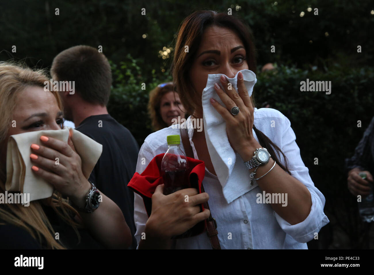 Bucharest, Romania - August 10, 2018: Women are covering the face to protect against tear gas during the violent anti-government protest in Bucharest. - Stock Image