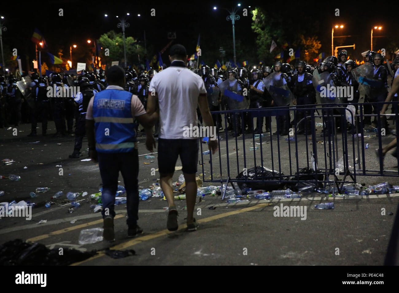 Bucharest, Romania - August 10, 2018: A gendarme is arresting a football supporter during  the violent anti-government protest in Bucharest. - Stock Image