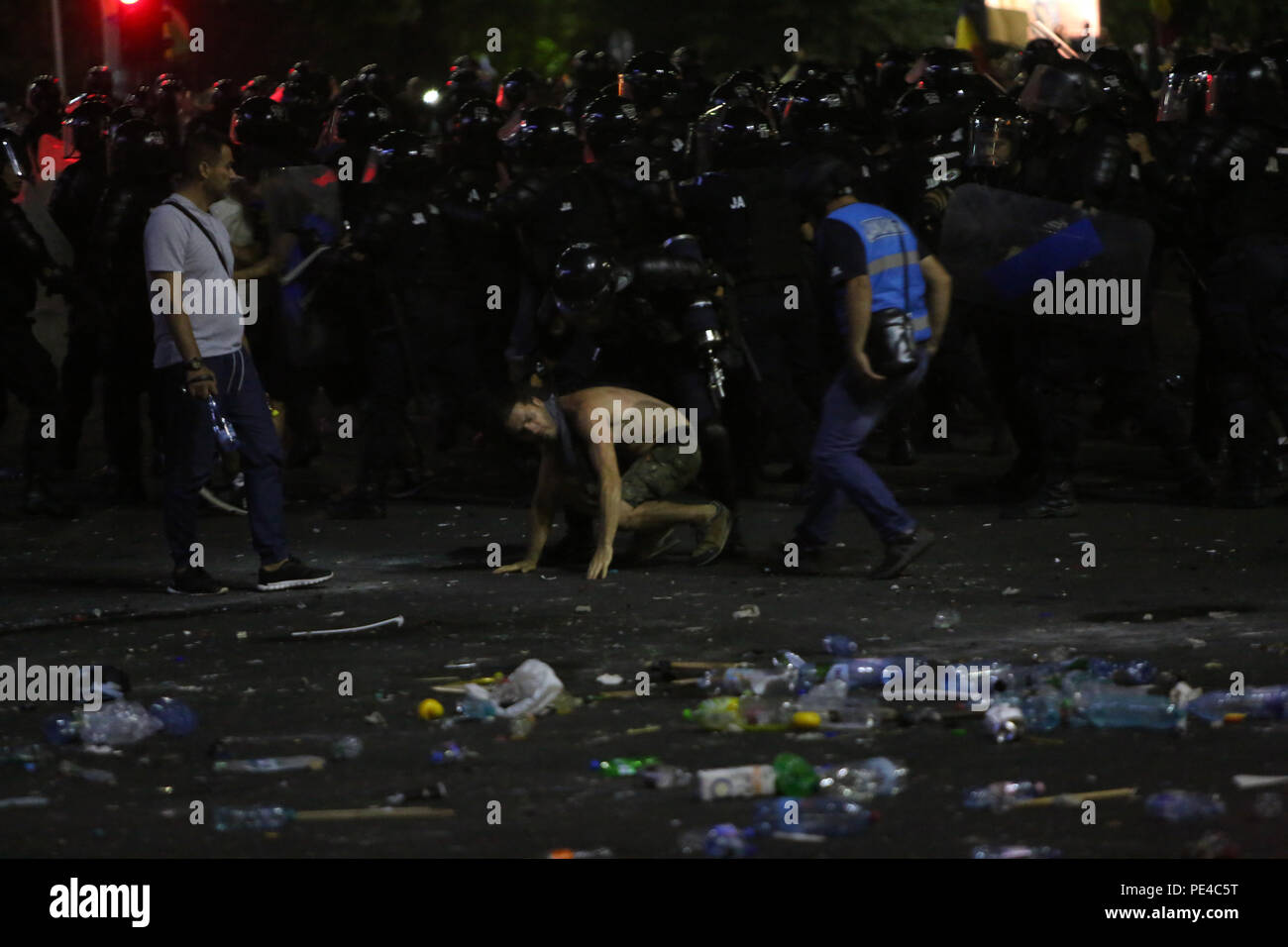 Bucharest, Romania - August 10, 2018: Gendarmes are arresting a violent football supporter during  the violent anti-government protest in Bucharest. - Stock Image