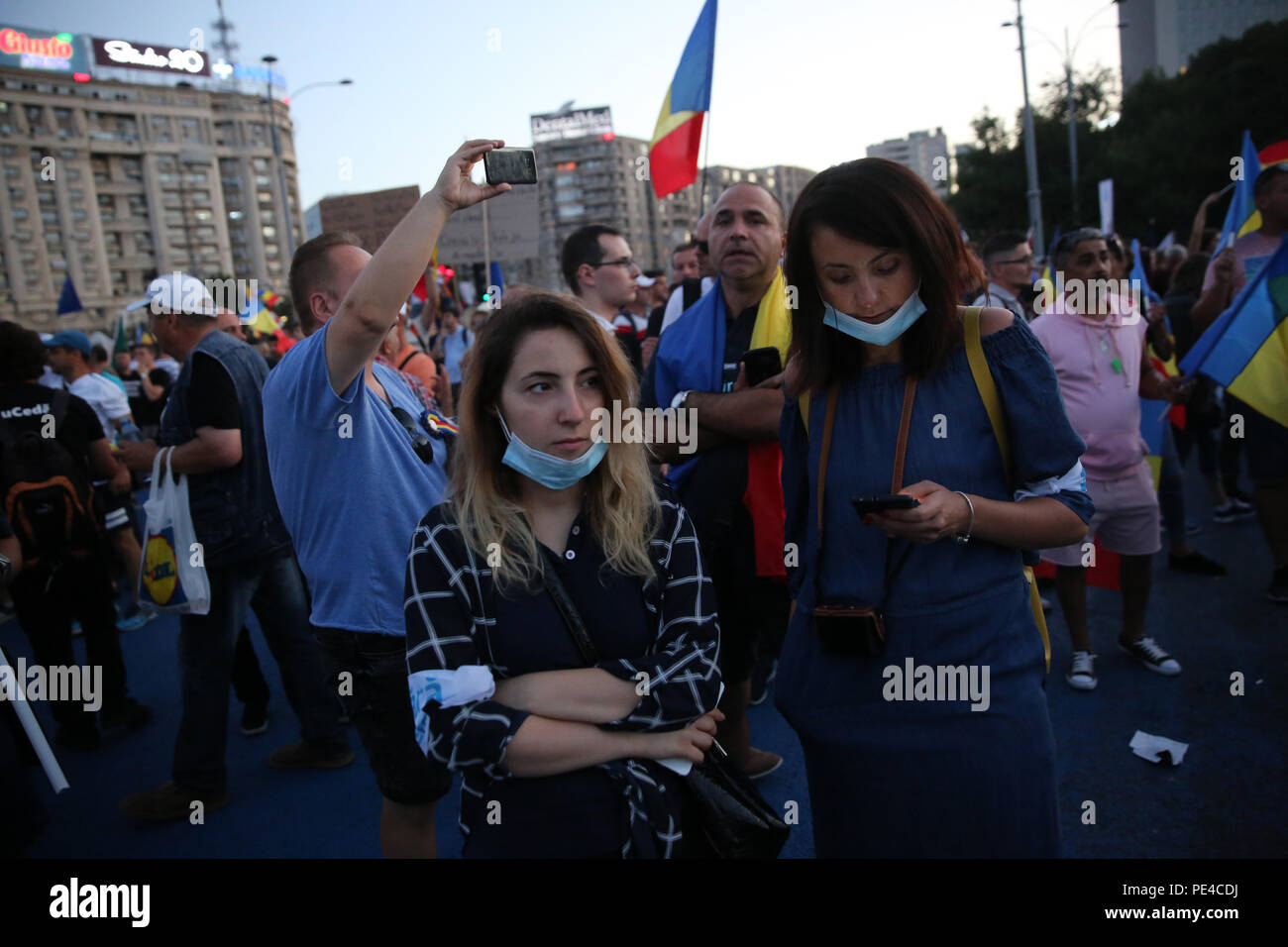 Bucharest, Romania - August 10, 2018: Tens of thousands of people are participating at violent anti-government protest in Bucharest. Over 400 people i - Stock Image