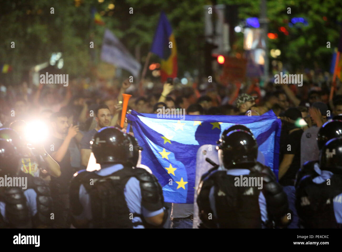 Bucharest, Romania - August 10, 2018: Tens of thousands of people are participating at violent anti-government protest in Bucharest. - Stock Image