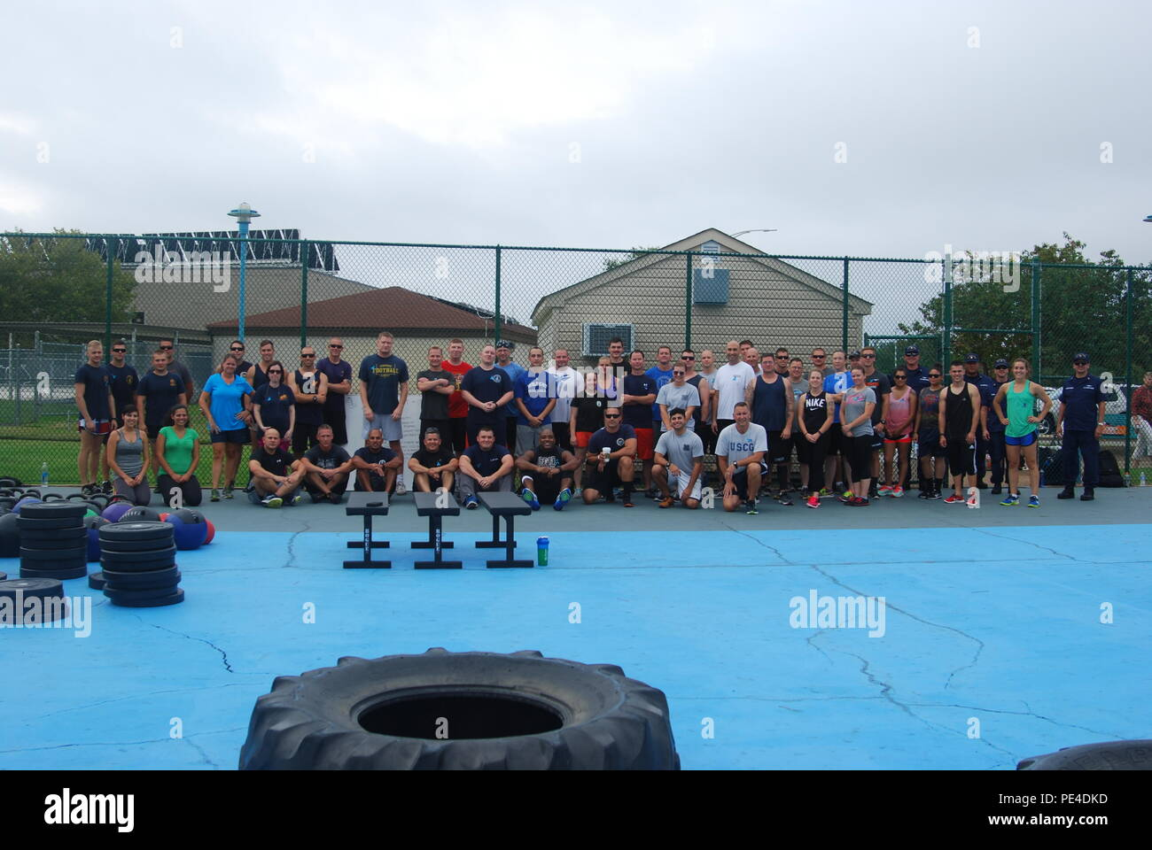 A group of Coast Guardsmen stationed at units in Portsmouth, Va., pose for a photo during Work Out to Speak Out, a group workout organized to raise awareness of suicide prevention, Sept. 10, 2015. Thirteen units across the Coast Guard participated in the event. (U.S. Coast Guard photo courtesy of Senior Chief Petty Officer Maria D'Angelo) - Stock Image