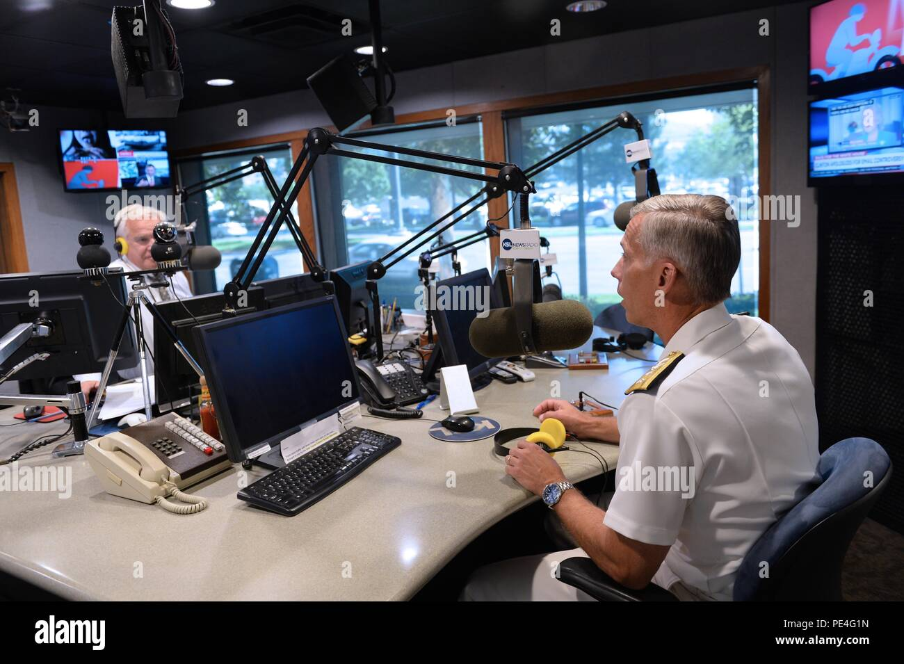 150909-N-RX128-017 SALT LAKE CITY, Utah (Sept. 9, 2015) – RADM Rick Snyder talks to Doug Wright during an interview on the Doug Wright radio show that airs in Salt Lake City. This event is part of the Salt Lake City Navy Week. (U.S. Navy photo by Mass Communication Specialist 3rd Class Nathan J. Lang) - Stock Image
