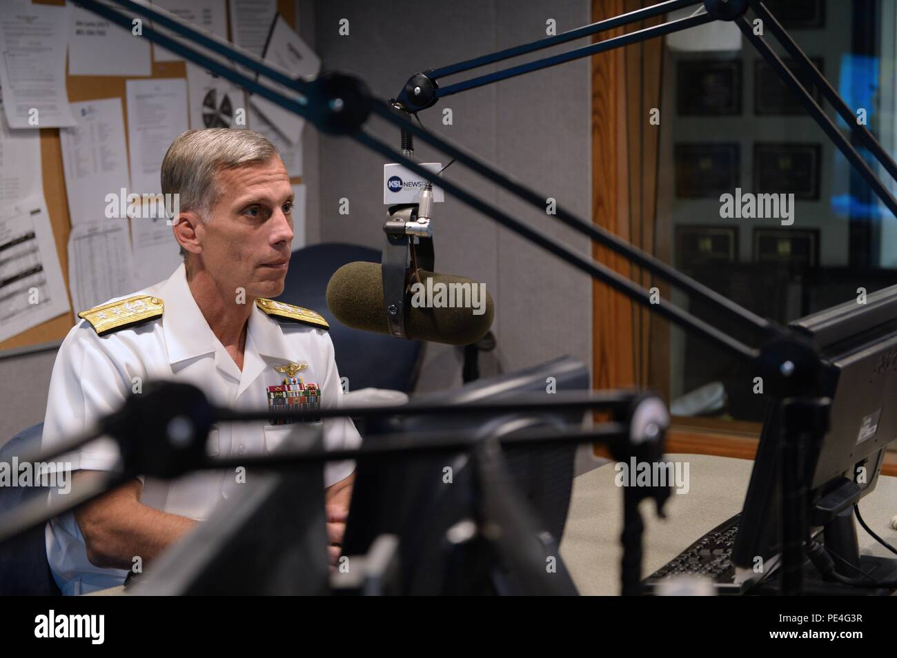 150909-N-RX128-012 SALT LAKE CITY, Utah (Sept. 9, 2015) – RADM Rick Snyder talks to Doug Wright during an interview on the Doug Wright radio show that airs in Salt Lake City. This event is part of the Salt Lake City Navy Week. (U.S. Navy photo by Mass Communication Specialist 3rd Class Nathan J. Lang) - Stock Image