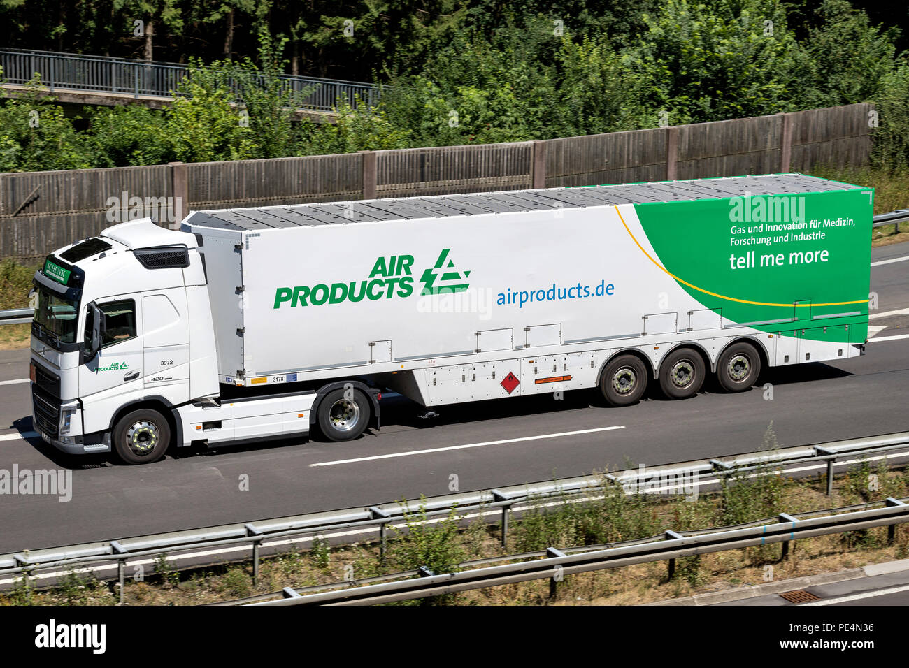 Air Products truck on motorway. Air Products is an American international corporation whose principal business is selling gases and chemicals. - Stock Image