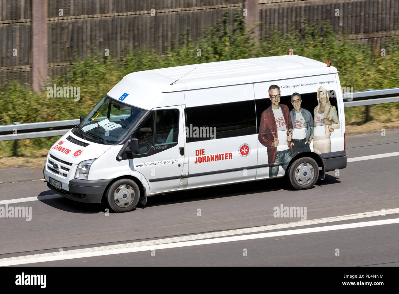 WIEHL, GERMANY - JUNE 30, 2018: Johanniter minibus on motorway. Die Johanniter is a voluntary humanitarian organisation. - Stock Image