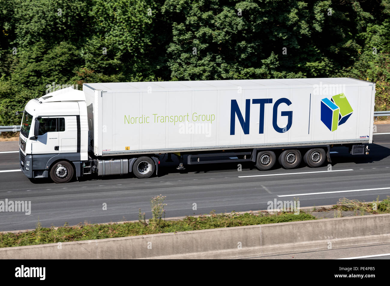 NTG truck on motorway.  NTG Group is a Danish logistics company with 2,000 vehicle units and 150,000 m² of warehouse surface.d - Stock Image
