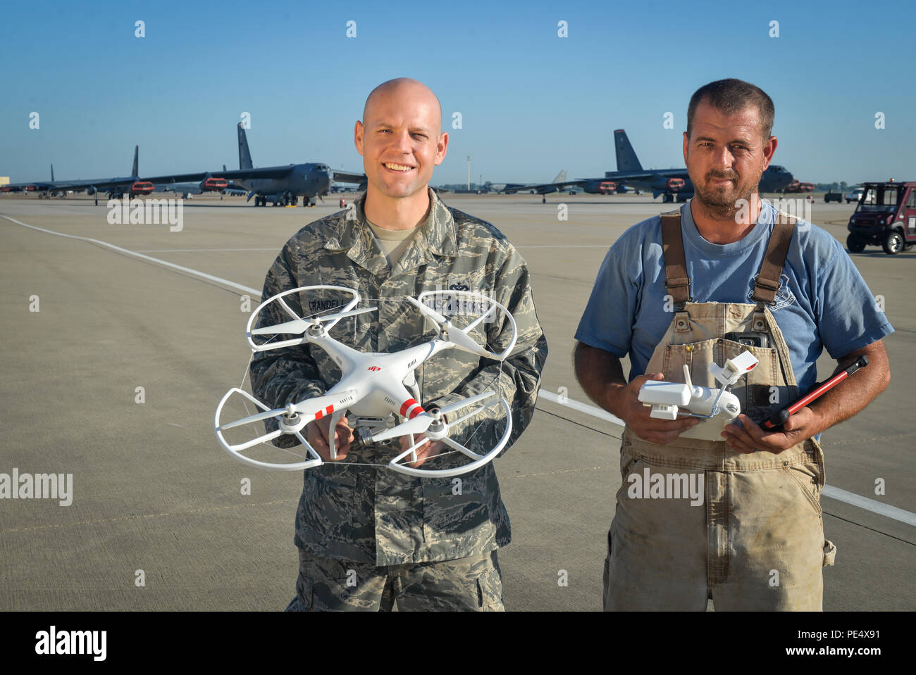 Tech. Sgt. Jonathan Crandell, 2nd Civil Engineer Squadron water and fuels system maintenance craftsman and Michael Scott, 2nd Civil Engineer Squadron, water and fuels utilized an aerial drone to provide accurate daily photography during the 2015 Defenders of Liberty Air Show.  Originally obtained for infrastructure assessments to decrease instances of Airmen performing harness-assisted, high-level climbing, the shop coordinated with the 2nd Security Forces Squadron, 2nd Communications Squadron, 2nd CES, Federal Aviation Administration and air show subject matter experts to ensure a safe and us - Stock Image