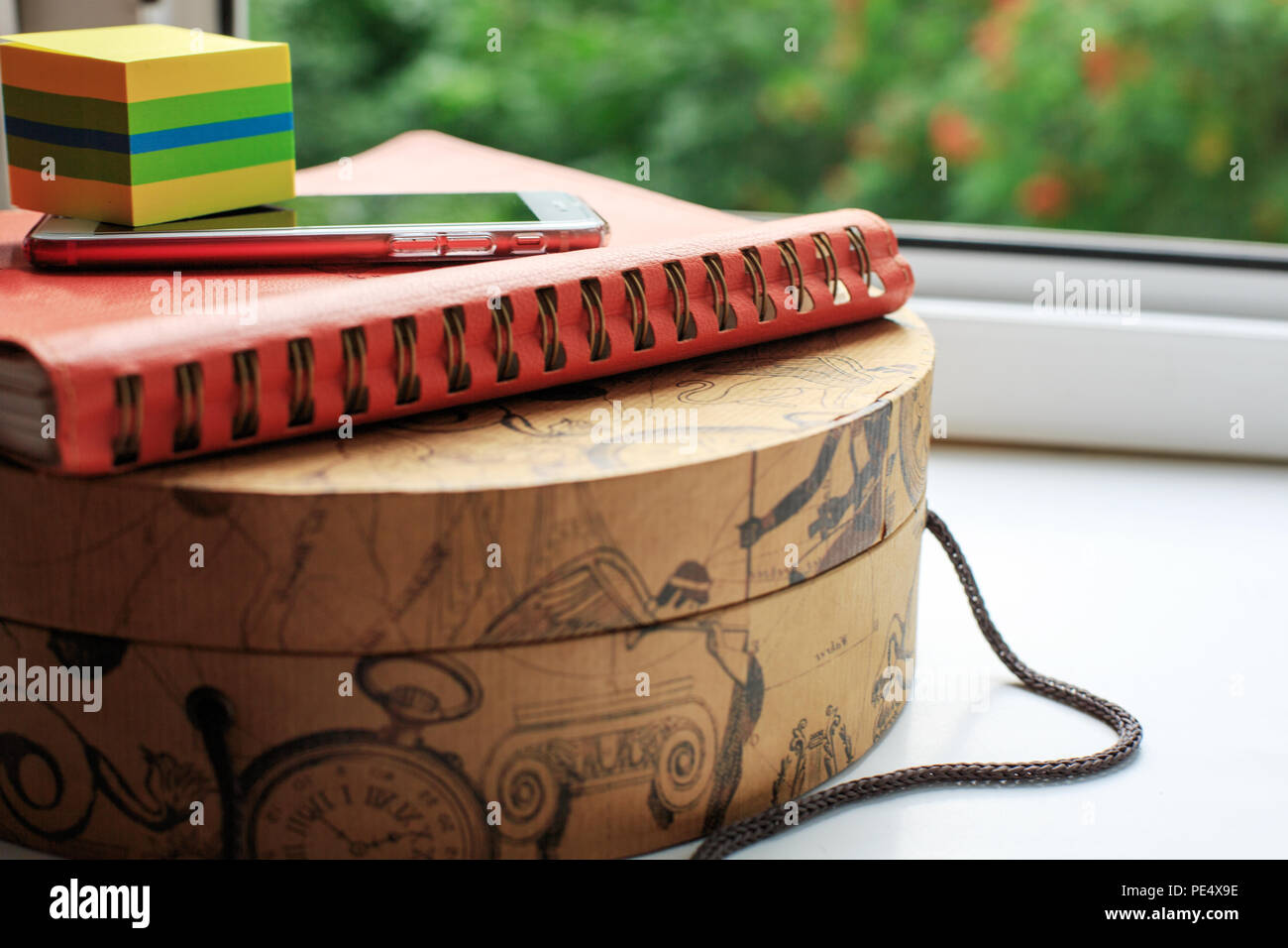 Diary and mobile phone on round carton box. Business concept - Stock Image