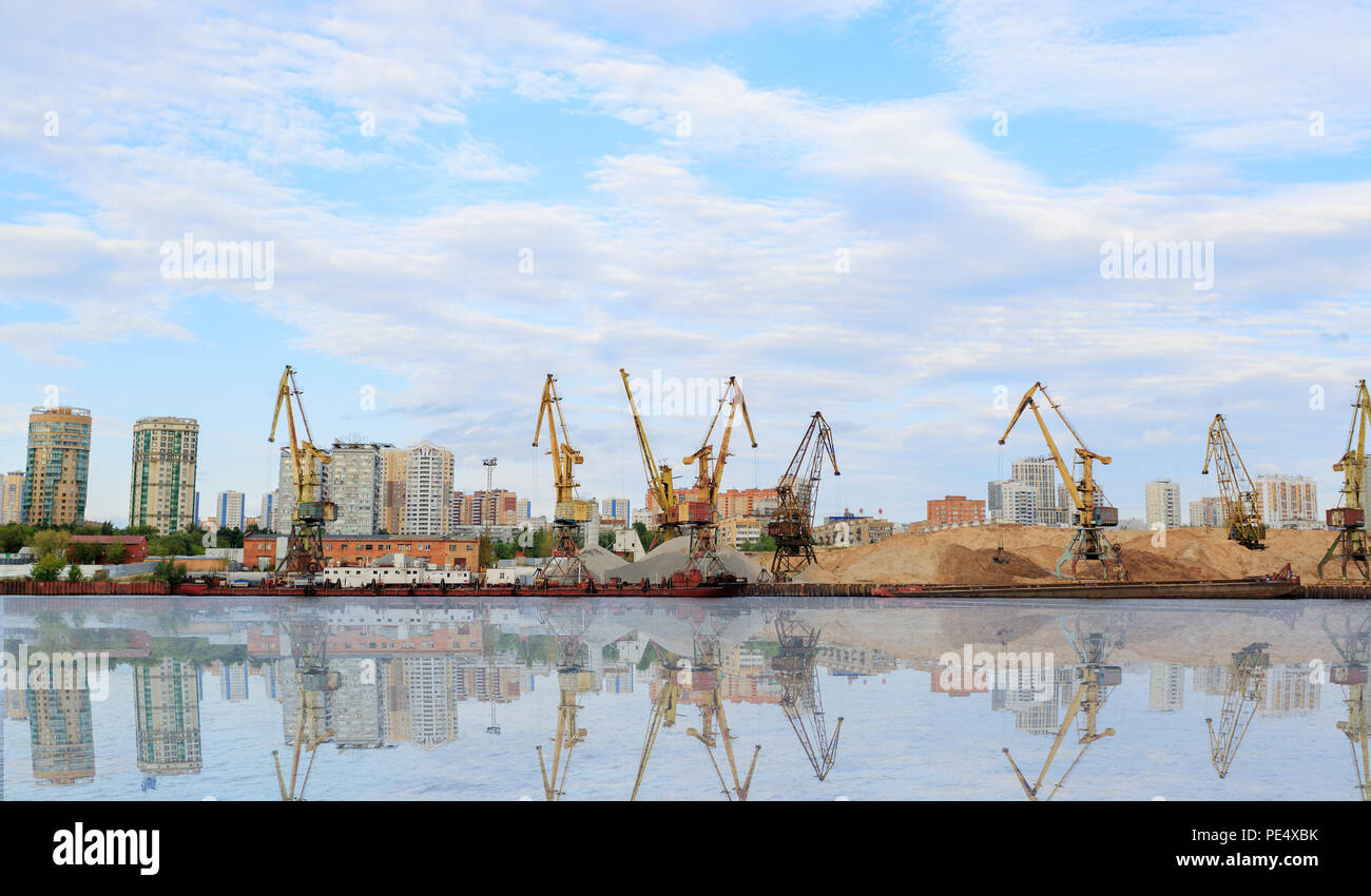 Cargo cranes in port terminal . The shore of the river Moscow. - Stock Image