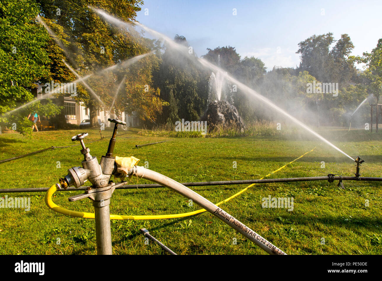 Baden-Baden, Lichtentaler Allee park, watering in the morning, irrigation of the green areas, while the whole of Germany is moaning under the summer h - Stock Image