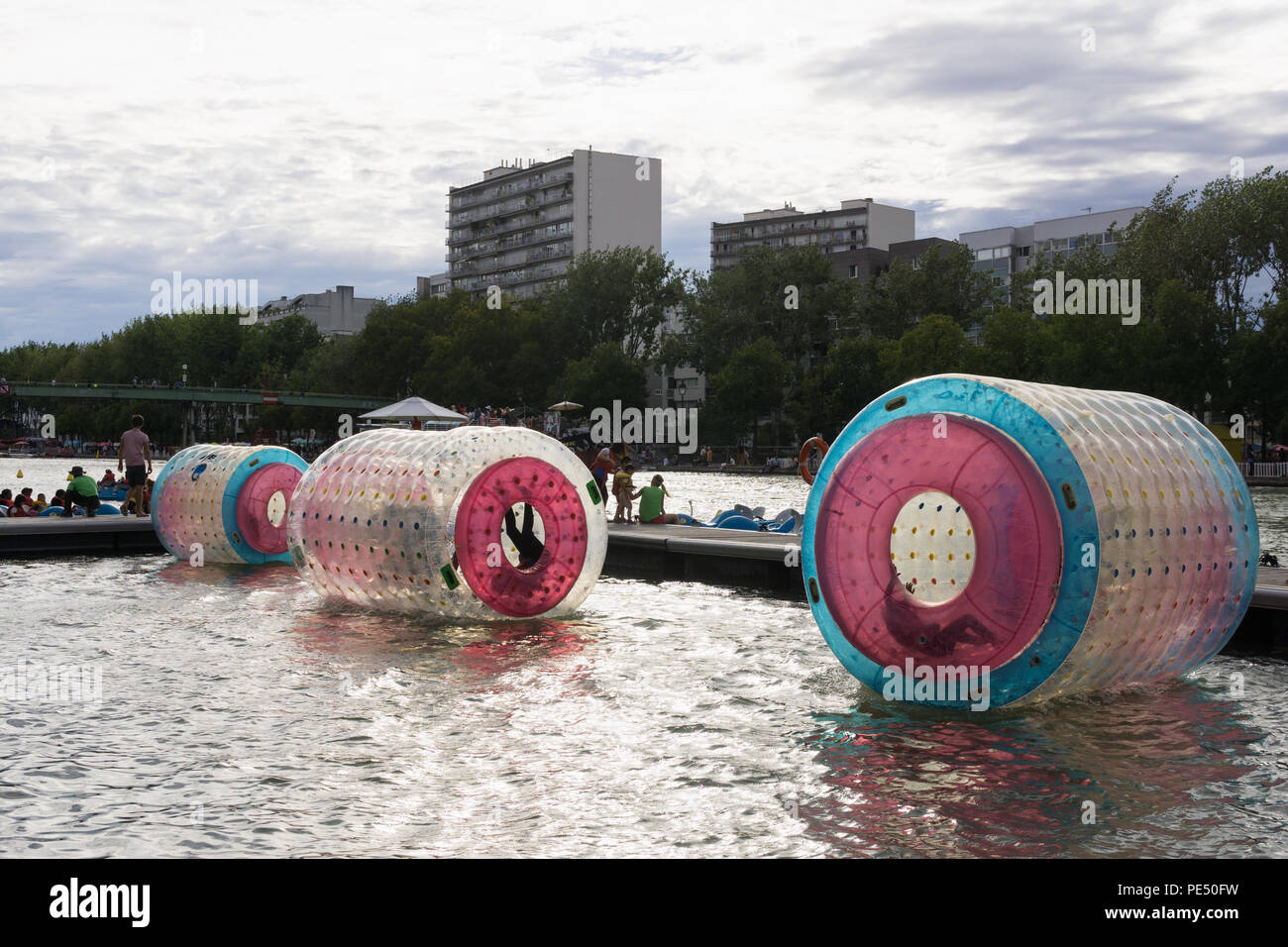 Water rolling balls in an open air pool during the Paris Plages event, France. - Stock Image