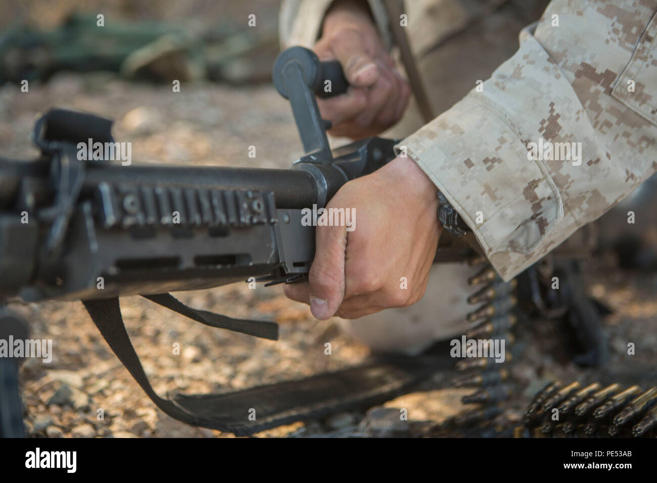 U.S. Marine Corps Lance Cpl. Ryan Fifer, with Marine Wing Support Squadron 374 (MWSS-374), changes the barrel for the M240B during an air ground defense exercise at Landing Zone Bull, Chocolate Mountain Aerial Gunnery Range, Calif., Oct. 10, 2015. This exercise was part of the Weapons and Tactics Instructor (WTI) 1-16, a seven week training event, hosted by Marine Aviation Weapons and Tactics Squadron One (MAWTS-1) cadre, which emphasizes operational integration of the six functions of Marine Corps aviation in support of a Marine Corps Air Ground Task Force. MAWTS-1 provides standardized advan - Stock Image