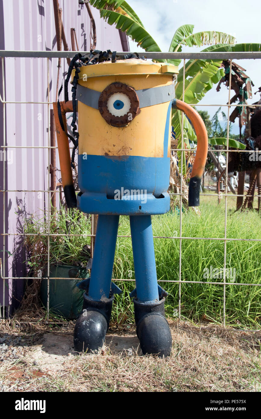 A Minion character trash can made from recycled scrap metal on the street outside Wally's junk art gallery, in Rankins Springs, NSW, Australia. - Stock Image