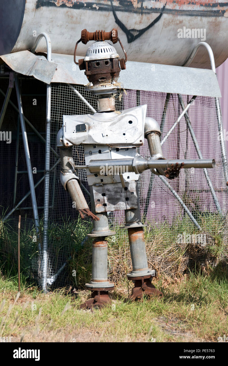 A robot sculpture made from recycled scrap metal outside Wally's junk art gallery, in Rankins Springs, New South Wales, Australia. - Stock Image