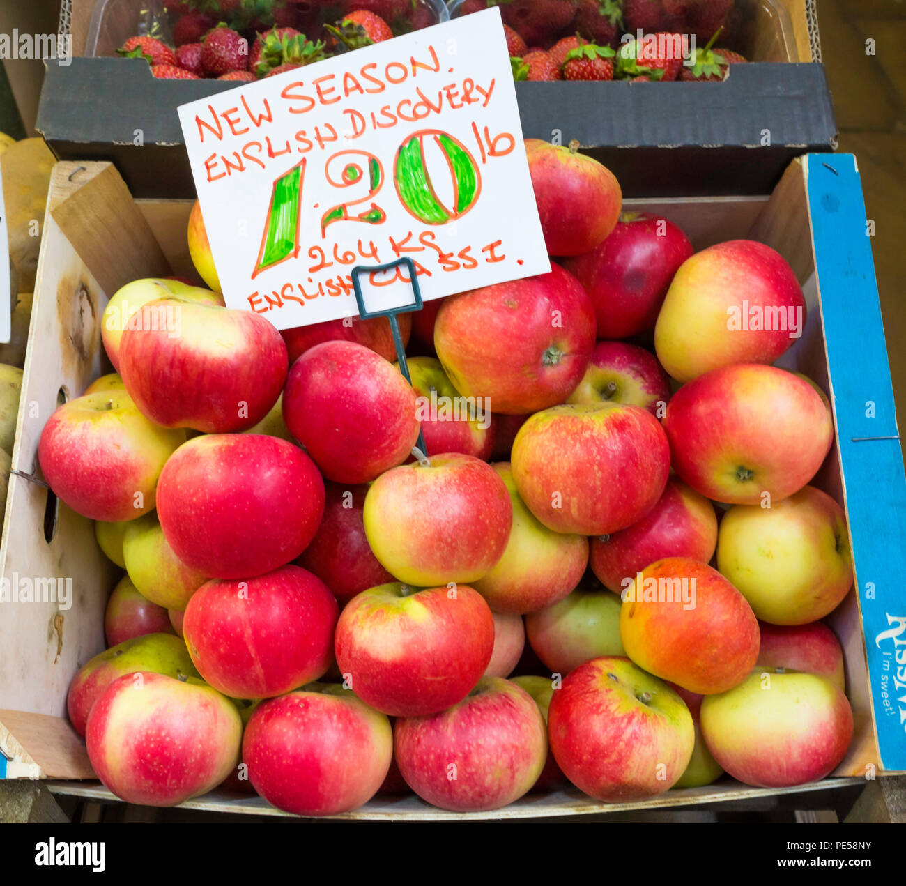 New Season English Class 1 Discovery apples for sale in greengrocers stall in Darlington County Durham priced at £1.20 per pound or £2.64 per Kilo Stock Photo