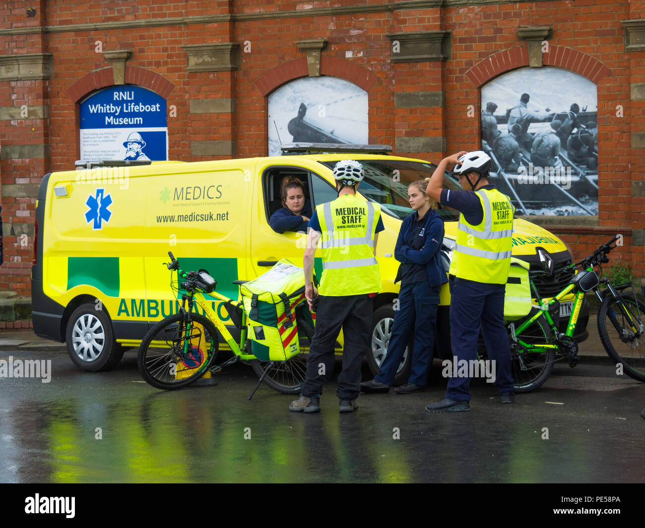 Medics Emergency Response Ambulance service on bicycles in crowded town centre not easily accessible for vehicles during the Whitby Regatta Stock Photo