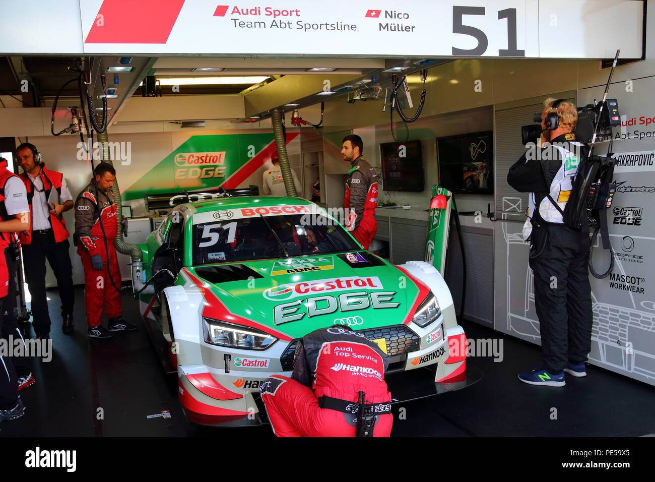 Mechanics preparing their car for the race at the DTM 2018 at Brands Hatch Circuit, Longfield, UK - Stock Image