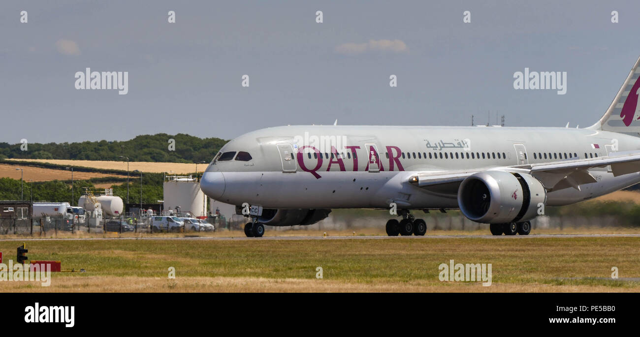 Qatar Airways Boeing 787 Dreamliner landing at Cardiff Wales Airport. The thrust reverser flap is open to aid braking - Stock Image