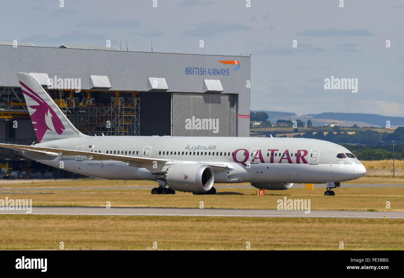 Qatar Airways Boeing 787 Dreamliner taxiing to the Terminal building landing at Cardiff Wales Airport. Stock Photo