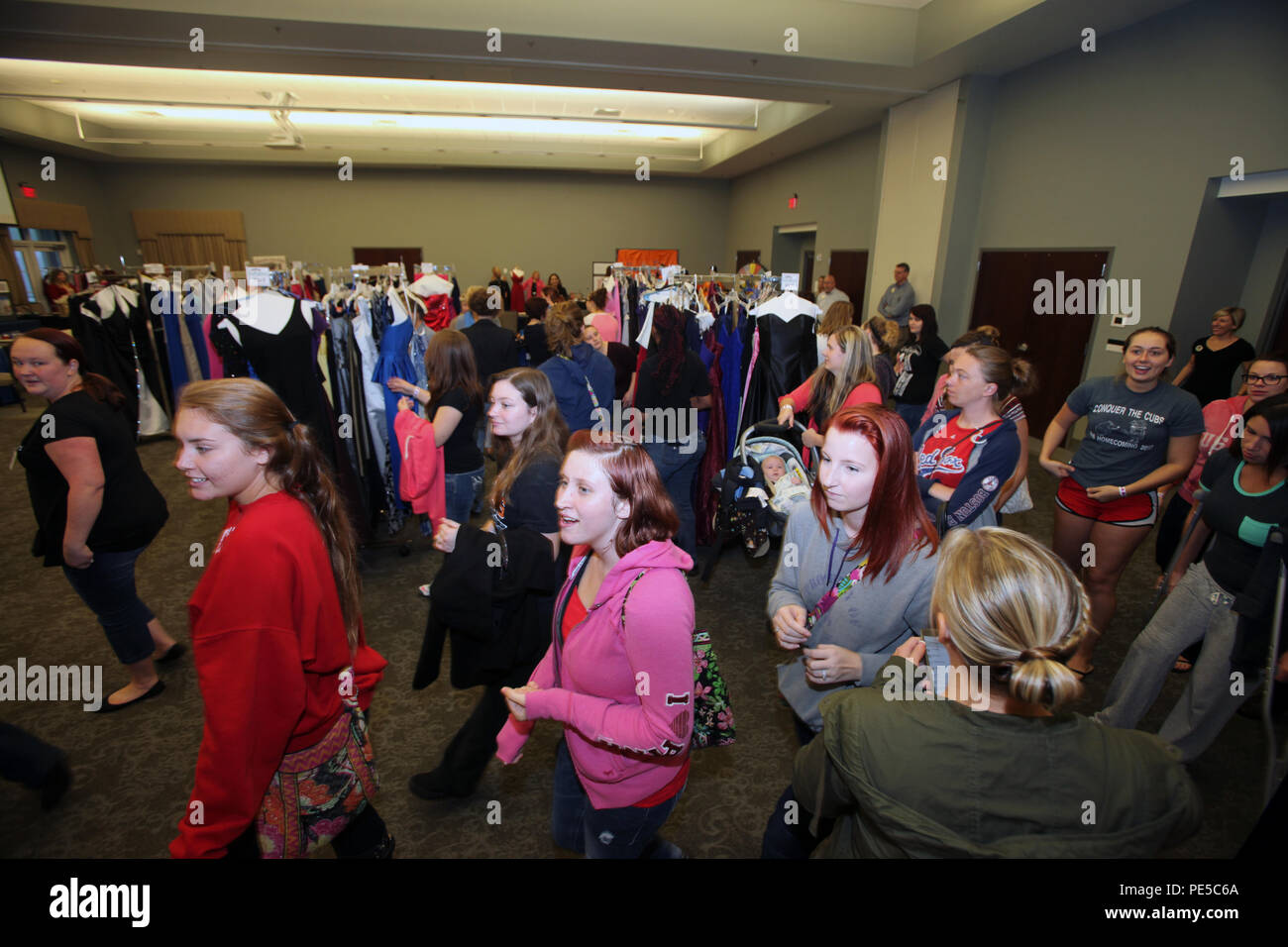 Spouses of active-duty Marines rush in to select a free ball gown ...