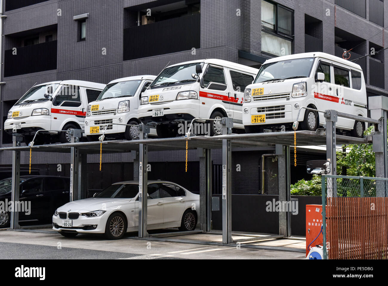 Cars stacked in a multi floors parking because of the lack of space, Kyoto Japan - Stock Image