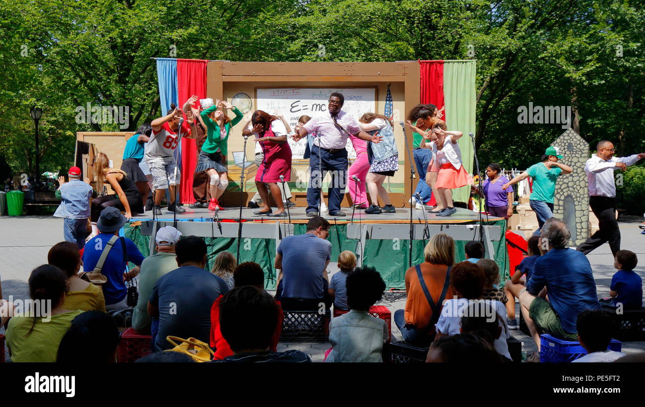 Theater for the New City street theater company performing in front of an audience in Central Park, New York, NY. - Stock Image