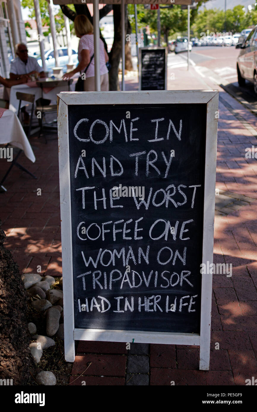 Humerous sign reflecting a bad review on tripadvisor outside a restaurant in Franschhoek, South Africa. - Stock Image
