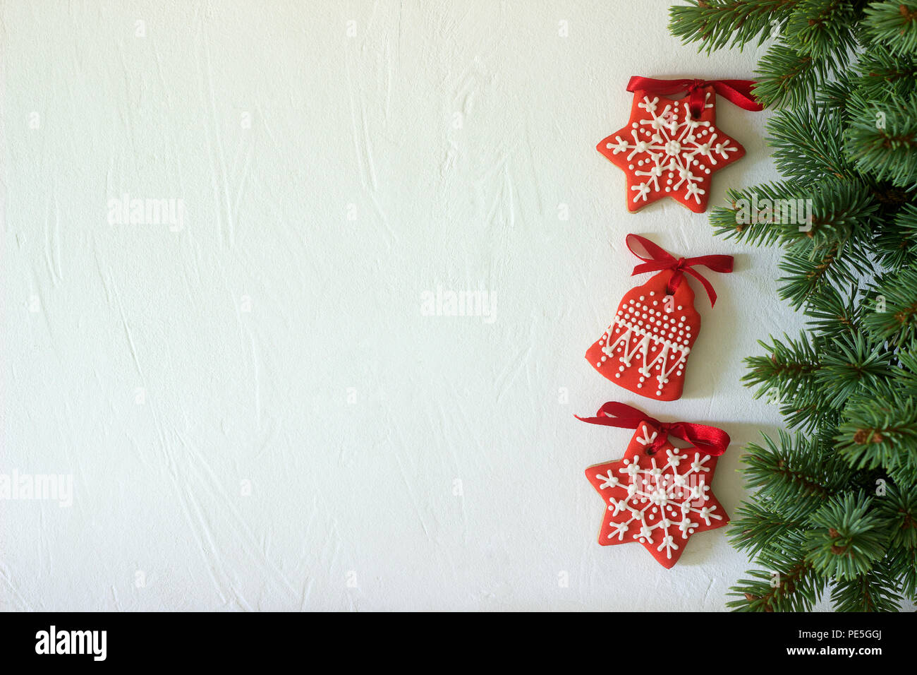 christmas new year holiday background red gingerbread cookies on white table top view copy space