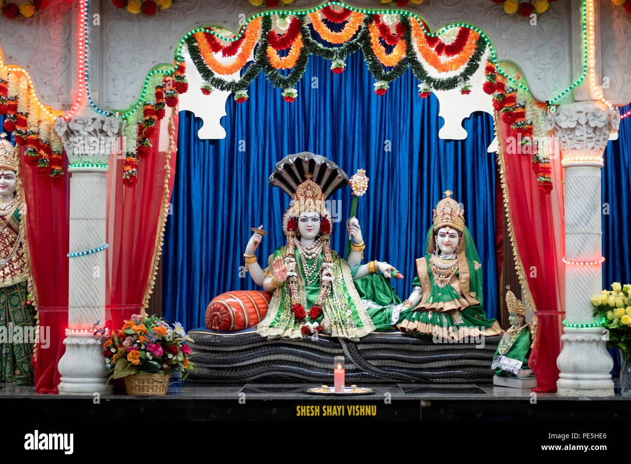 Statues of the Hindu deities Lakshmi and Narayan at a temple in Woodside, Queens, New York. - Stock Image