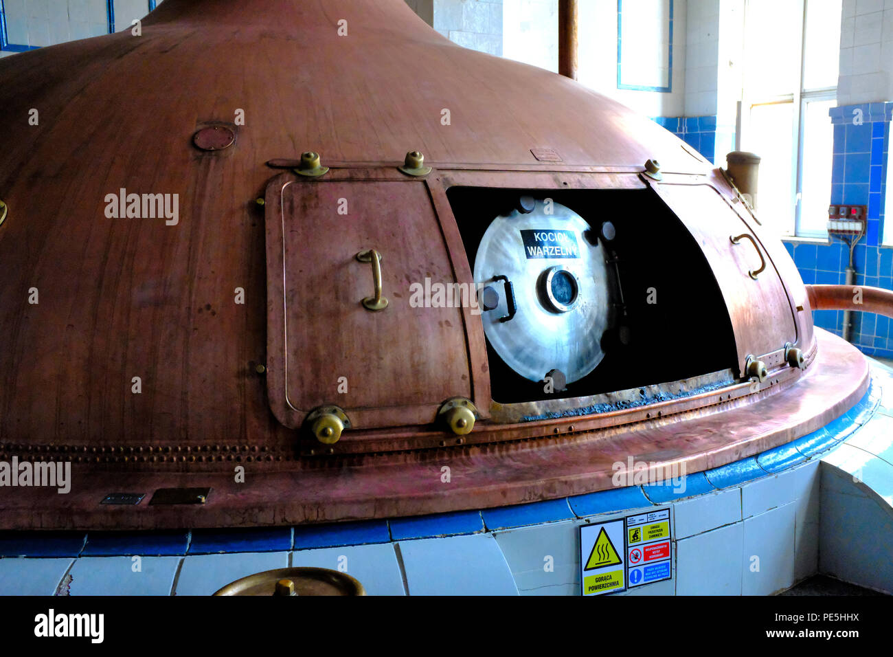 Brewing copper pot stills at the Tychy (Tyskie) Brewery in Poland, Europe. - Stock Image