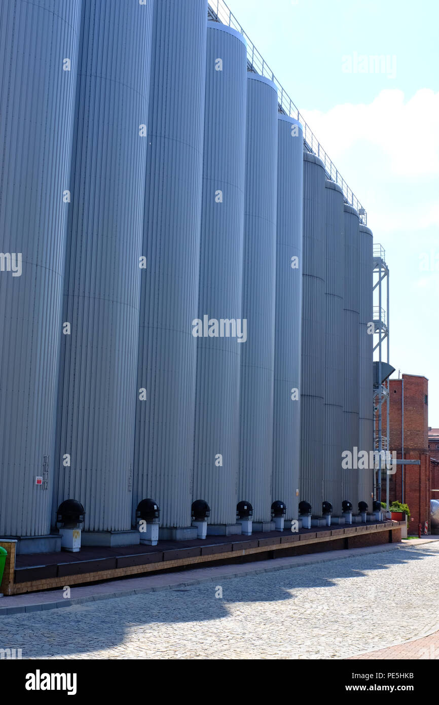 Beer storage tanks at the Tychy (Tyskie) Brewery in Poland, Europe. - Stock Image