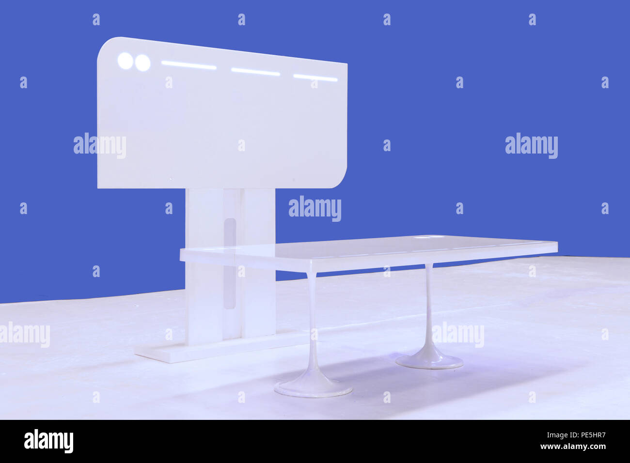 the mackup of modern table and monitor with LED light look like from sci-fi movie - Stock Image